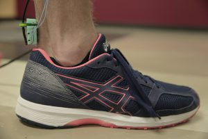 The UW-Madison engineers' device for measuring tendon tension is placed over a person's Achilles tendon. Photo: Renee Meiller.